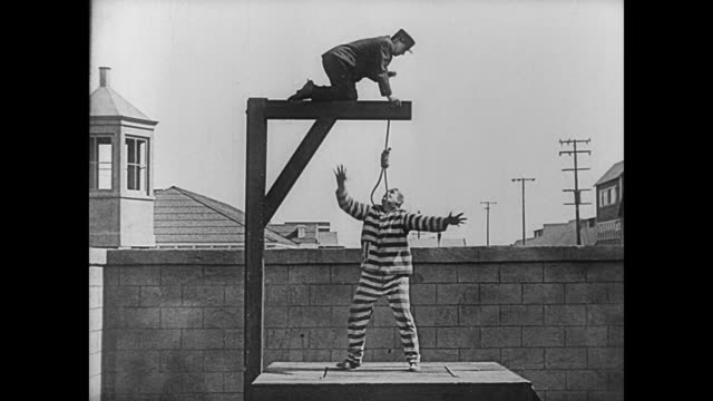 1920 prison guard (buster keaton) becomes assistant warden by catching bully convict (joe roberts) - prison release stock videos & royalty-free footage