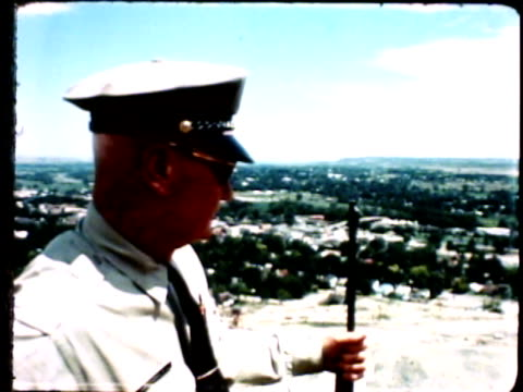 prison guard standing w/ rifle in hand on balcony of high watchtower, overlooking csp buildings & facilities, landscape & trees bg. co, jail - prison guard stock videos & royalty-free footage