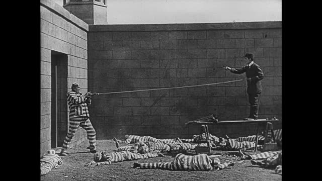 1920 prison guard uses ball and chair to knock out bully convict (joe roberts) - prison cell door stock videos & royalty-free footage