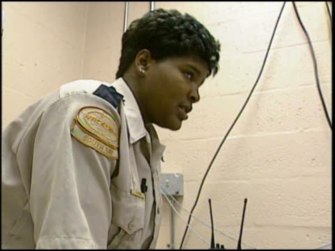 stockvideo's en b-roll-footage met prison guards operate and patrol wackenhut corrections - gevangenisbewaker
