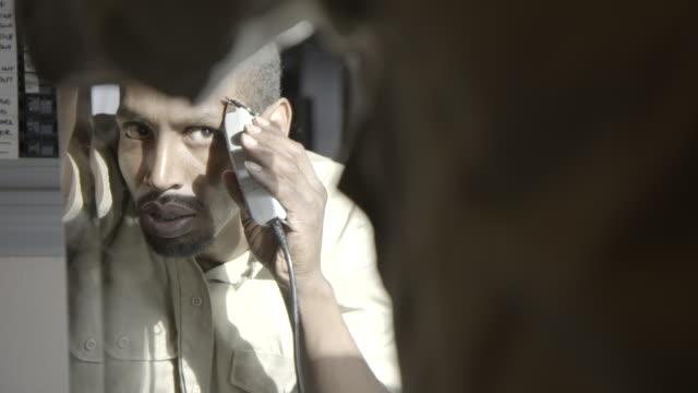 prison inmate cuts hair in mirror - razor stock videos & royalty-free footage