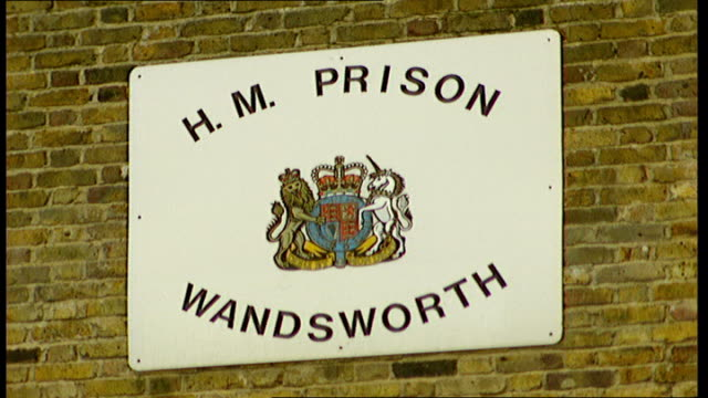 Prison officers face disciplinary action over transfer of prisoners during inspections LIB Sign for HM Prison Wandsworth General view prison building...