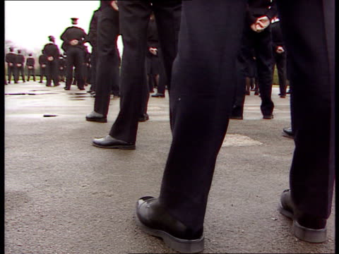 prison officers training; itn england: wakefield: ext vs new recruits on parade / instructor passes along line inspecting recruits / recruits march... - military recruit stock videos & royalty-free footage