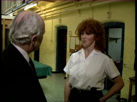 London Wormwood Scrubs Prison Home Secretary David Waddington being shown into another area meeting female prison officer / being shown cell chatting...