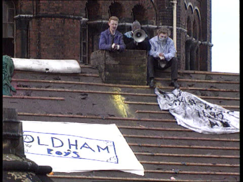 prison overcrowding; itn lib england: manchester: strangeways prison: ext seq prisoners in rooftop protest - hm prison manchester stock videos & royalty-free footage
