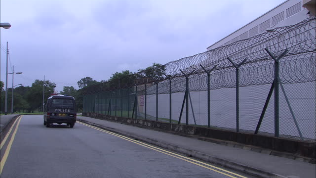ms, tu, prison surrounded with barbed wire fence, singapore - barbed wire stock videos & royalty-free footage