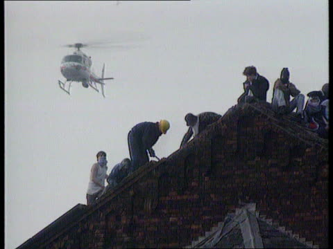 prison system reforms; england: strangeways: prisoners some masked and hooded kicking tiles off prison roof lms prisoners ripping slates off roof and... - hm prison manchester stock videos & royalty-free footage