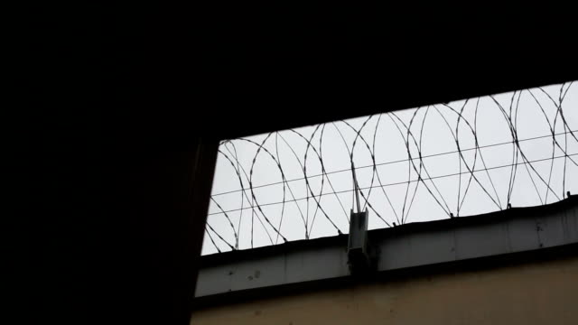 prison wall, wire mesh, sky - north korea stock videos & royalty-free footage
