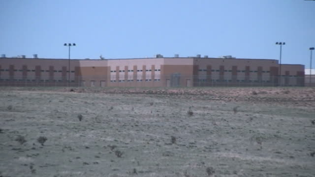 (hd1080i) prison, zoom out - prison wall stock videos & royalty-free footage