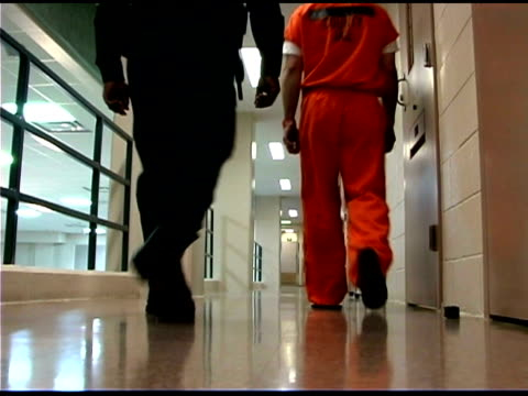 prisoner and officer walking - prisoner stock videos & royalty-free footage