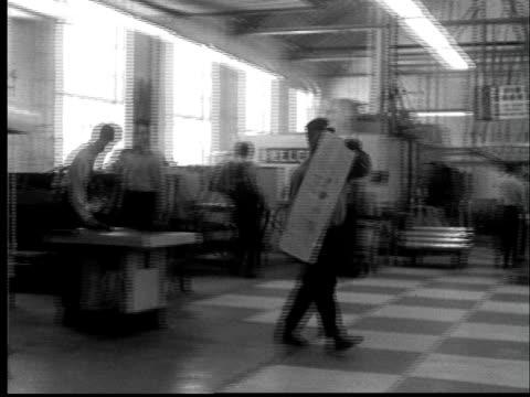 1956 ws pan prisoner carrying sheet of metal across metal shop/ lansing, kansas  - sheet metal stock videos and b-roll footage