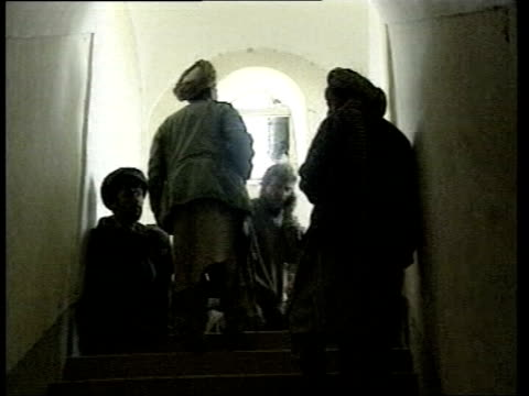 inquiry demanded; lib afghanistan: mazar-i-sharif: kalai djangi fort: ext gv entrance to fort gv group of taliban fighters? sitting by wall with... - raw footage stock videos & royalty-free footage