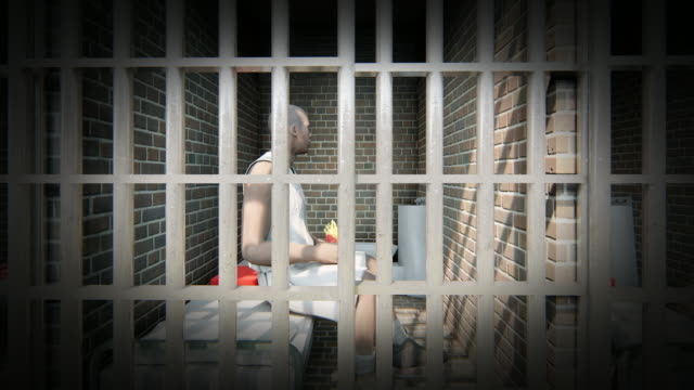 prisoner in cell eating chips - inside of stock videos and b-roll footage