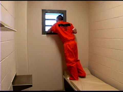 prisoner in jail cell - jail cell stock videos & royalty-free footage