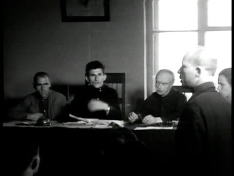 prisoner in people's court young couple signing registration book couple working on paperwork at table hands paying for a service. - 1935 stock videos & royalty-free footage