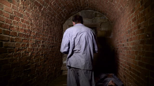 prisoner looking out of cell and pacing in a 1930s era reenactment on january 01, 2016. . - reenactment stock videos & royalty-free footage