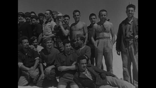 prisoner of war camp in desert with italian naval prisoners / group of prisoners, tents in bag / pan of prisoners / pan italian sailor, others behind... - italian culture stock-videos und b-roll-filmmaterial