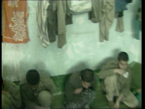 prisoner of war camp in ramadi; itn iraq: ramadi: ext / 16 year old iranian soldier /