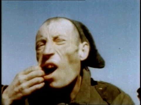 prisoner opening mouth and showing missing teeth / buchenwald weimar thuringia germany - campo di concentramento di buchenwald video stock e b–roll
