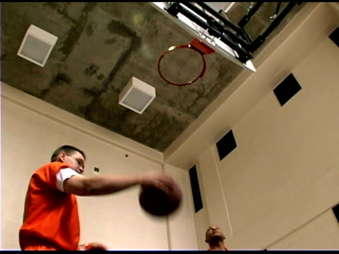 prisoner playing basketball - prison jumpsuit stock videos & royalty-free footage