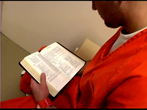 Prisoner reading book