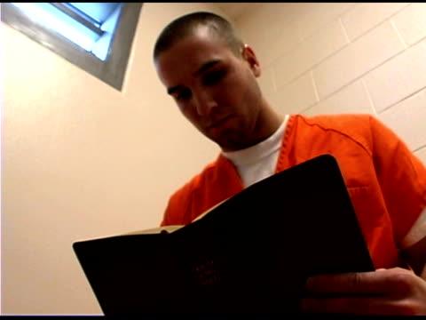 prisoner reading - prison jumpsuit stock videos & royalty-free footage