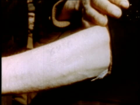 prisoner showing number branded on forearm / buchenwald weimar thuringia germany - campo di concentramento di buchenwald video stock e b–roll