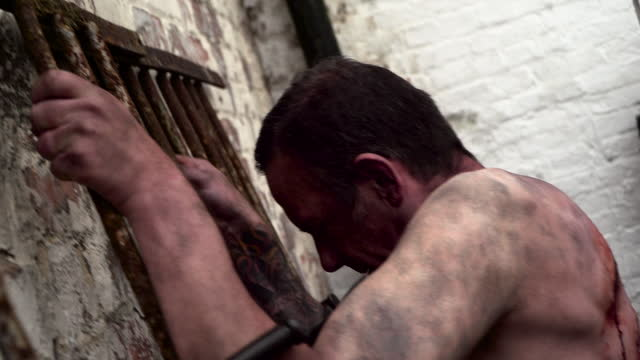 prisoner whipped in prison courtyard by guards in a 1930s era reenactment on january 01, 2016. . - reenactment stock videos & royalty-free footage