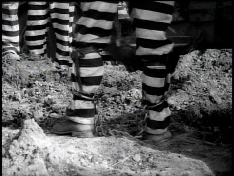 1938 ms prisoner working with legs in shackles / georgia, usa - chain点の映像素材/bロール