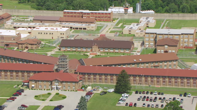 WS ZO AERIAL POV Prisoners coming out of prison at Pendleton Correctional Facility / Fall Creek Township, Madison County, Indiana, United States
