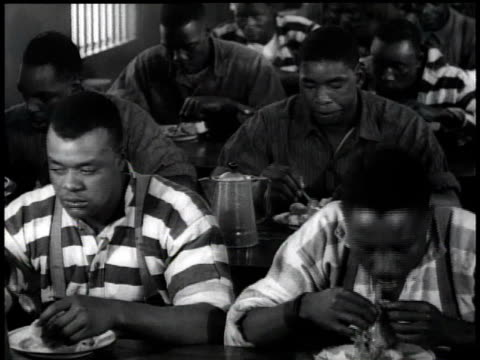 vídeos de stock, filmes e b-roll de 1938 ms prisoners eating / georgia, usa - prisoner