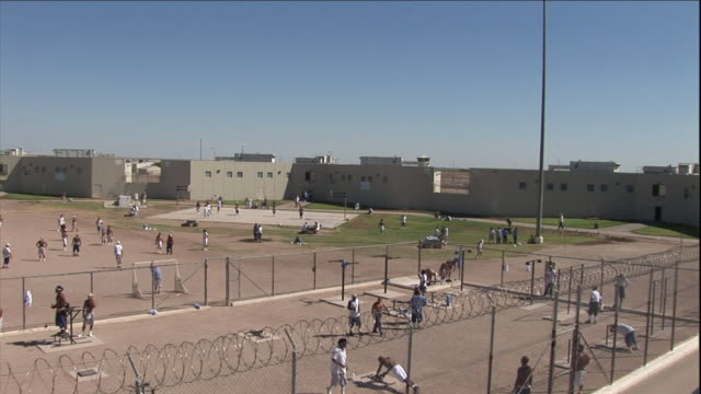 prisoners exercise in a prison yard. - prison stock videos & royalty-free footage