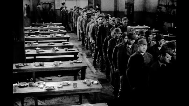 vídeos de stock, filmes e b-roll de 1939, prisoners filing into prison dining hall - 1930 1939