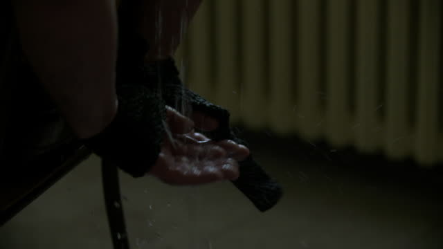 CU of prisoner's hands during waterboarding session