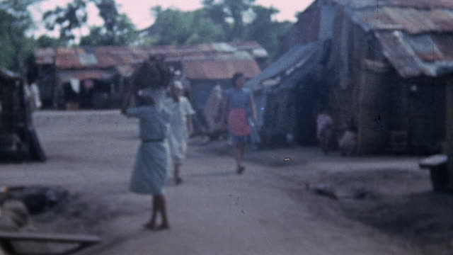 prisoners in prison camp, walking on street between shacks / saipan, mariana islands - pacific war stock videos & royalty-free footage