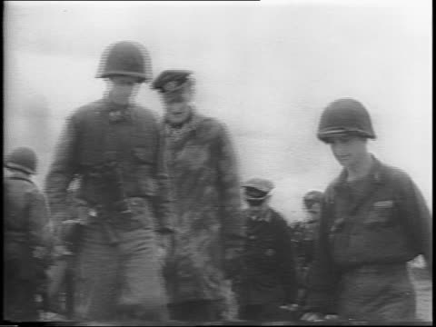 prisoners of the axis powers are captured and march in a line / captured german officer covers his face as he walks by / captured soldiers walking... - axis powers stock videos & royalty-free footage