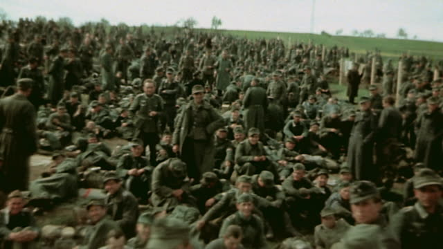 vidéos et rushes de prisoners of war behind barbed wire fencing officers and soldiers / germany - 1945