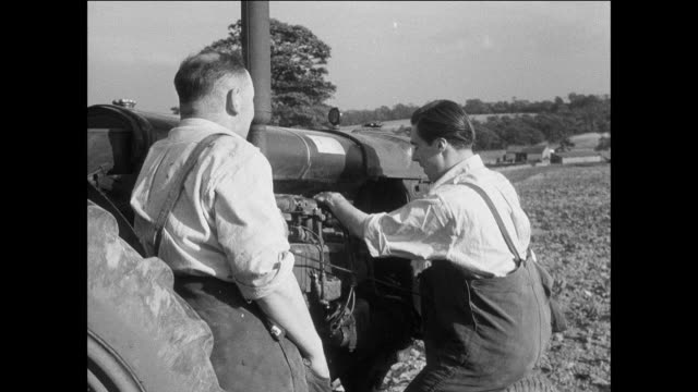 montage prisoners repair a farm tractor / uk / mechanic fixes engine / prisoners talk / prisoner walks to front of tractor and cranks - prisoner education stock videos & royalty-free footage