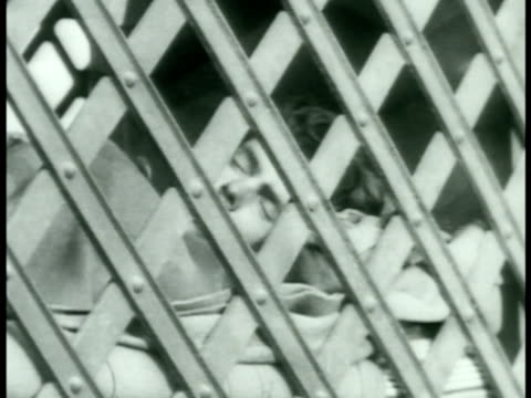 prisoners sleeping in portable cage guard walking upper perimeter of prison punishment men in stripped uniforms sitting standing breaking rocks... - chain stock videos and b-roll footage
