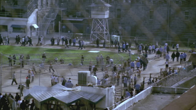 ha ws prisoners walking in prison yard at folsom state prison / folsom, california, usa - 囚人点の映像素材/bロール