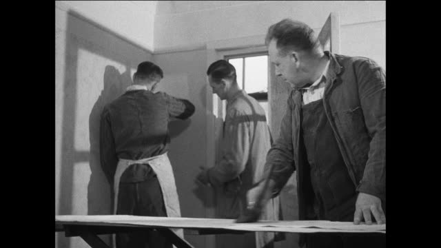 montage prisoners work and improve skills / uk / prisoners build a brick wall / prisoners hang wall paper / prisoner operates machine in shop / prisoners work in a garden / prisoner plays organ / prisoners learn architecture - prisoner education stock videos & royalty-free footage