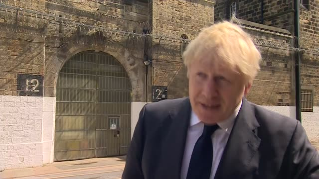 boris johnson visits prison in leeds - shown scanning equipment, shown round prison and attends meeting; england: west yorkshire: hmp leeds: ext... - leeds stock videos & royalty-free footage