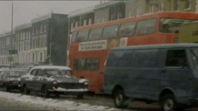 prison officers on strike over pay dispute 1978 / 1979 winter of discontent footage including shot past traffic in street with snow on ground london... - 1978 stock videos & royalty-free footage
