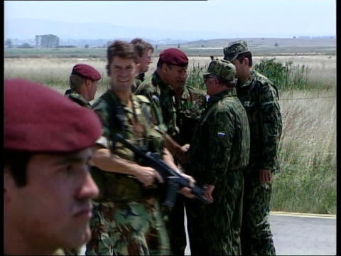 KOSOVO Pristina Airport KFOR troops on duty at airport CMS KFOR paratrooper on duty with two other soldiers MS Soldier in turret of tank looking thru...