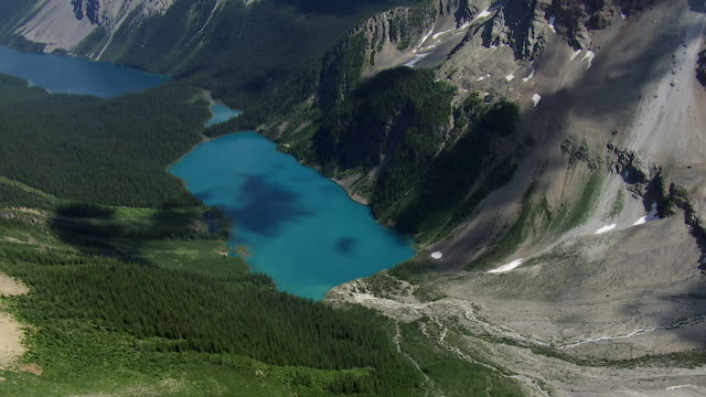 pristine lake in banff national park canada - banff stock videos & royalty-free footage