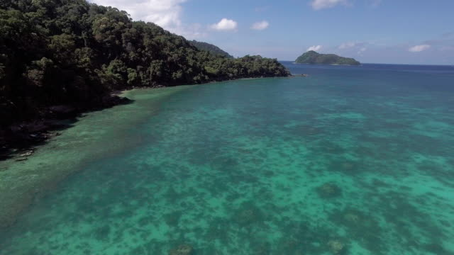 pristine waters of a deserted private island ko surin, thailand - david ewing stock-videos und b-roll-filmmaterial
