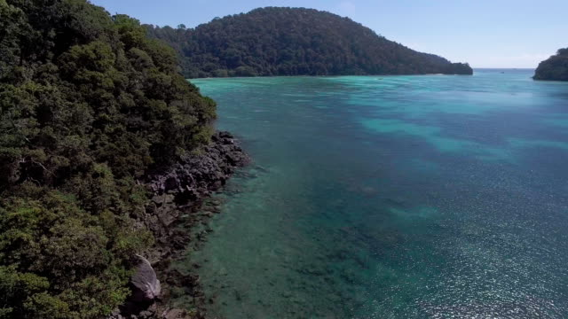 pristine waters of a deserted private island ko surin, thailand - david ewing stock videos & royalty-free footage