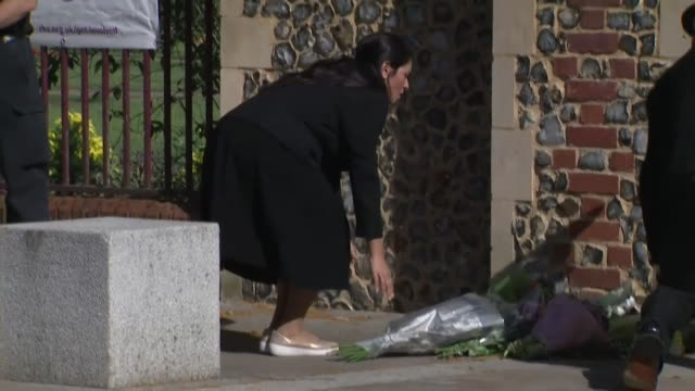 priti patel, home secretary, lays flowers outside forbury gardens, reading, where three men were killed during a knife attack terrorist incident - crime and murder stock videos & royalty-free footage