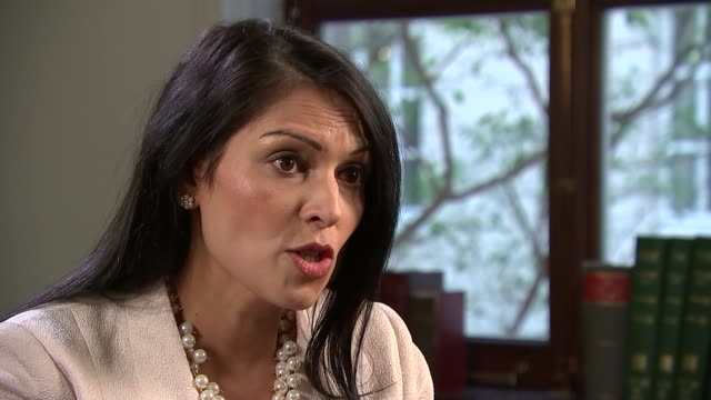 london int priti patel mp interview sot re somaliland - priti patel stock-videos und b-roll-filmmaterial