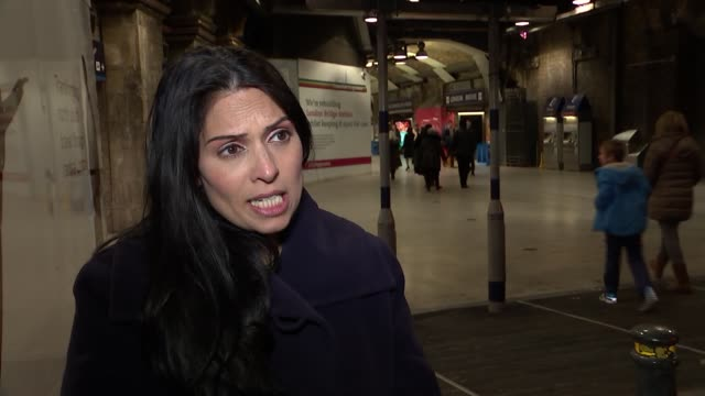 london london bridge ext priti patel mp interview sot re bombing of hospitals in aleppo - priti patel stock-videos und b-roll-filmmaterial